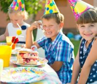 Children Eating Cake at Party