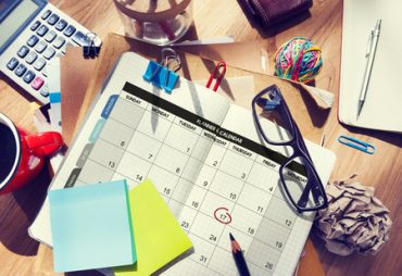 Calendar and planning supplies on a table
